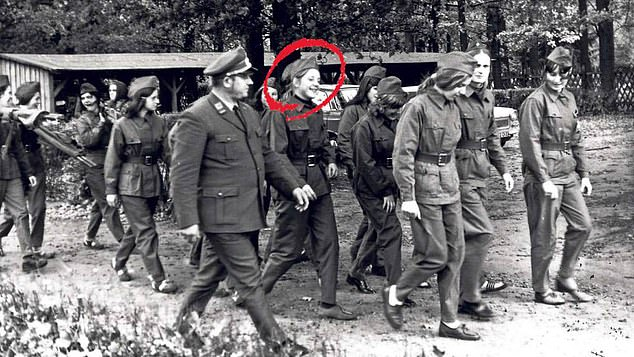 As a young woman, Merkel was taught to believe in a Soviet system that folded 15 republics into a single state, the Union of Soviet Socialist Republics (Angela Merkel pictured in 1972 at a youth training camp for the East German civil defence)