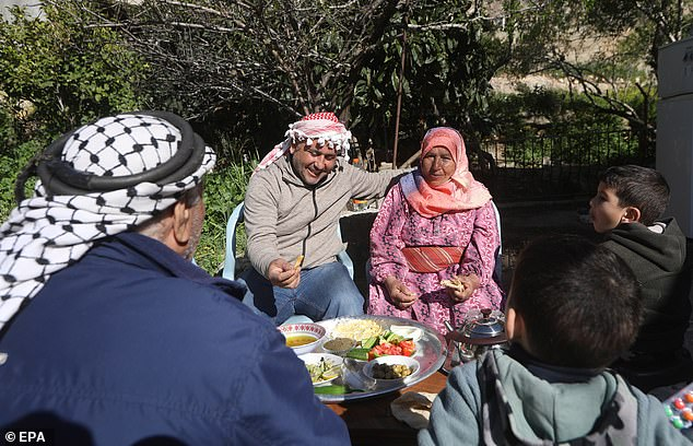 Palestinian Holwa Abu Ras, 80, and her family enjoyed a breakfast at her village of Al Sawiya near Nablus City, West Bank, ahead of the global observation