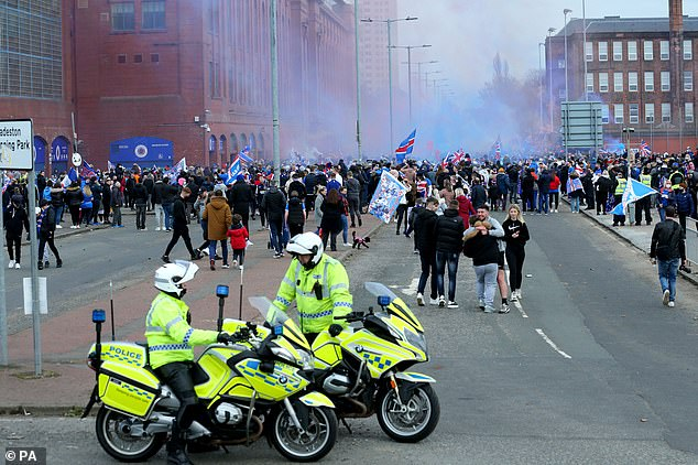 Police turned up to try and scatter the celebrating masses outside Rangers' Ibrox stadium