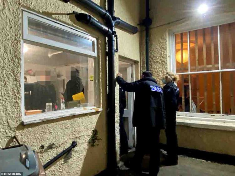 Breaking it up:Elsewhere in the UK on Saturday night, Nottinghamshire police broke up gatherings and handed out fines to those flouting lockdown rules (pictured at one party where three fines were handed out)
