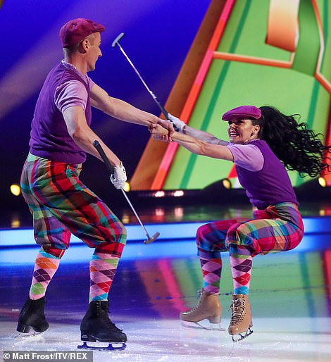 Fore! The pair donned checked golf pants and socks for the fun dance