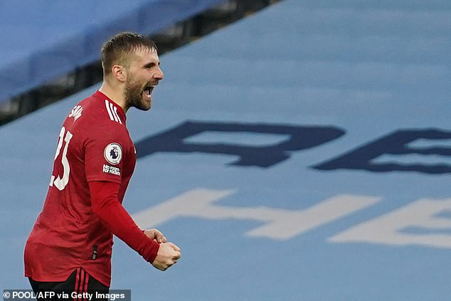 Luke Shaw celebrates after doubling Manchester United's lead at the Etihad on Sunday