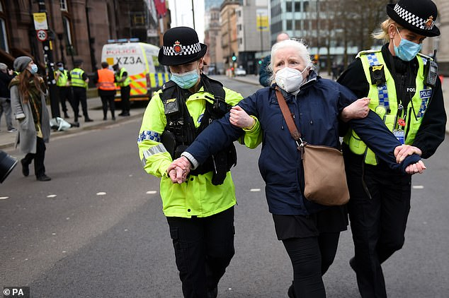 A 65-year-old woman (pictured) was also arrested at the protest in Manchester city centre at noon on Sunday after refusing to leave the scene and failing to provide details when asked