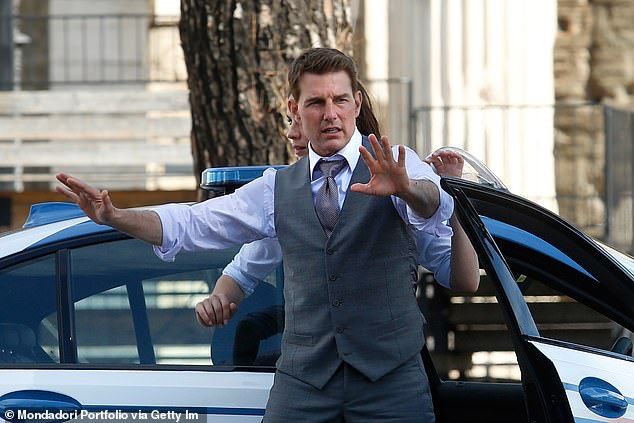 Taking it seriously: The actor, 58, has recently wrapped on his own movie Mission Impossible 7 following a series of delays and claims he 'ranted' at crew when they broke social distancing rules on set (pictured filming in Rome in October)