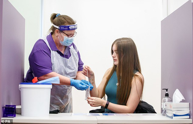 Most of Britain's primary schools will reopen their doors this morning - despite major pushback from teaching unions who call for a more staggered approach. Pictured:Student Leah Anderson takes a coronavirus lateral flow testat Outwood Academy Adwick in Doncaster
