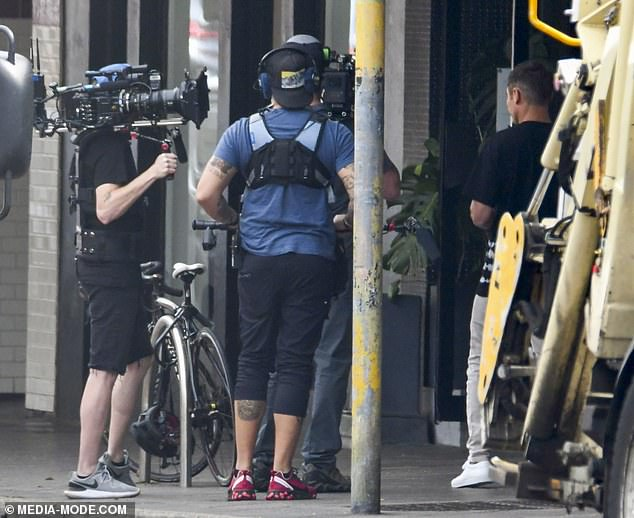 Work:Zac remained hidden from view during shooting, but was spotted talking to the camera in a black T-shirt and grey jogging bottoms