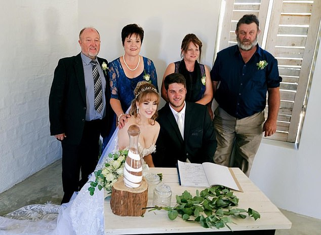 Gerhard van Wyk, far right, died on the way to hospital after apparently trying to wrestle a pistol out of Boulter's hands during the deadly barbecue scuffle in Namibia. His son and the daughter-in-law who was allegedly propositioned by Boulter are pictured at the front