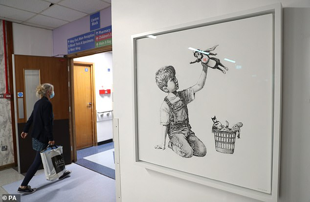 The Banksy work Game Changer appeared in May during the first lockdown at Southampton General Hospital featuring a young boy playing with a super hero nurse, leaving traditional superheros in a basket