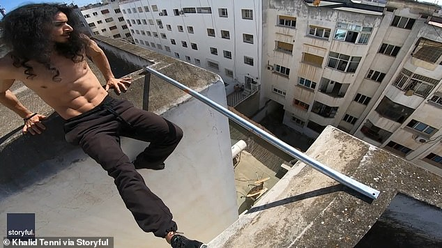 Khalid warmed up before deciding to move on to the main event as he sat down and swung his legs over the ledge of the roof