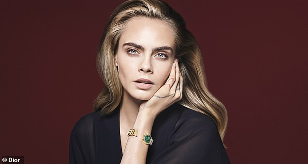 Natural beauty: Cara rocked a sleek semi-sheer top and she highlighted her face with soft makeup, her windswept braids tumbled in a loose wave