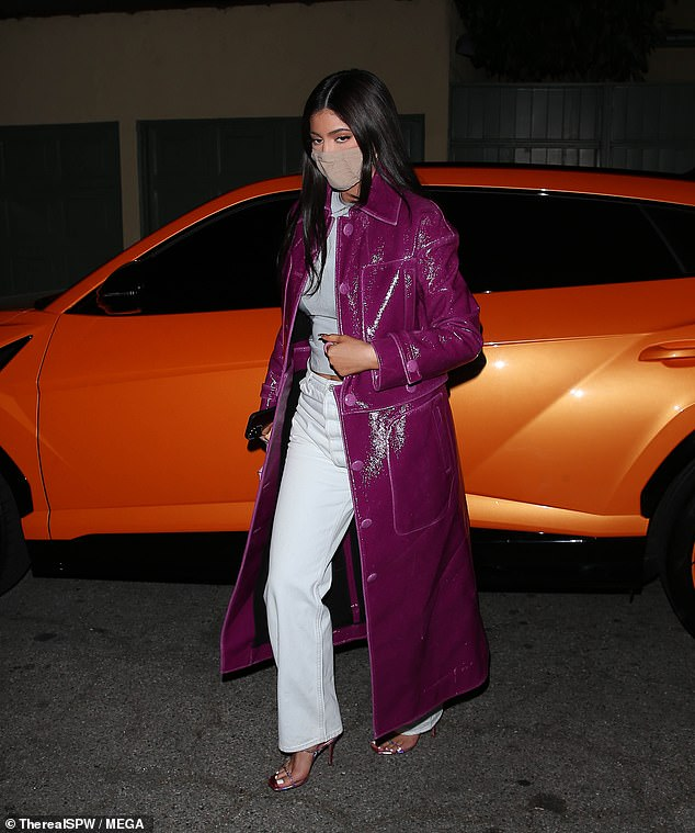 Make moves: The 23-year-old mogul teamed eye-catching outerwear with a gray top and white pants as she walked to the celebrity favorite restaurant.
