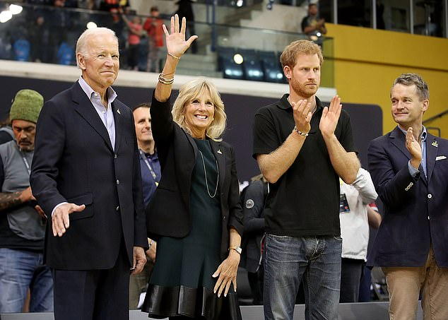 President Joe Biden (left) and first lady Jill Biden (center left) appear alongside Prince Harry (right) at the Invictus Games in Toronto in 2017