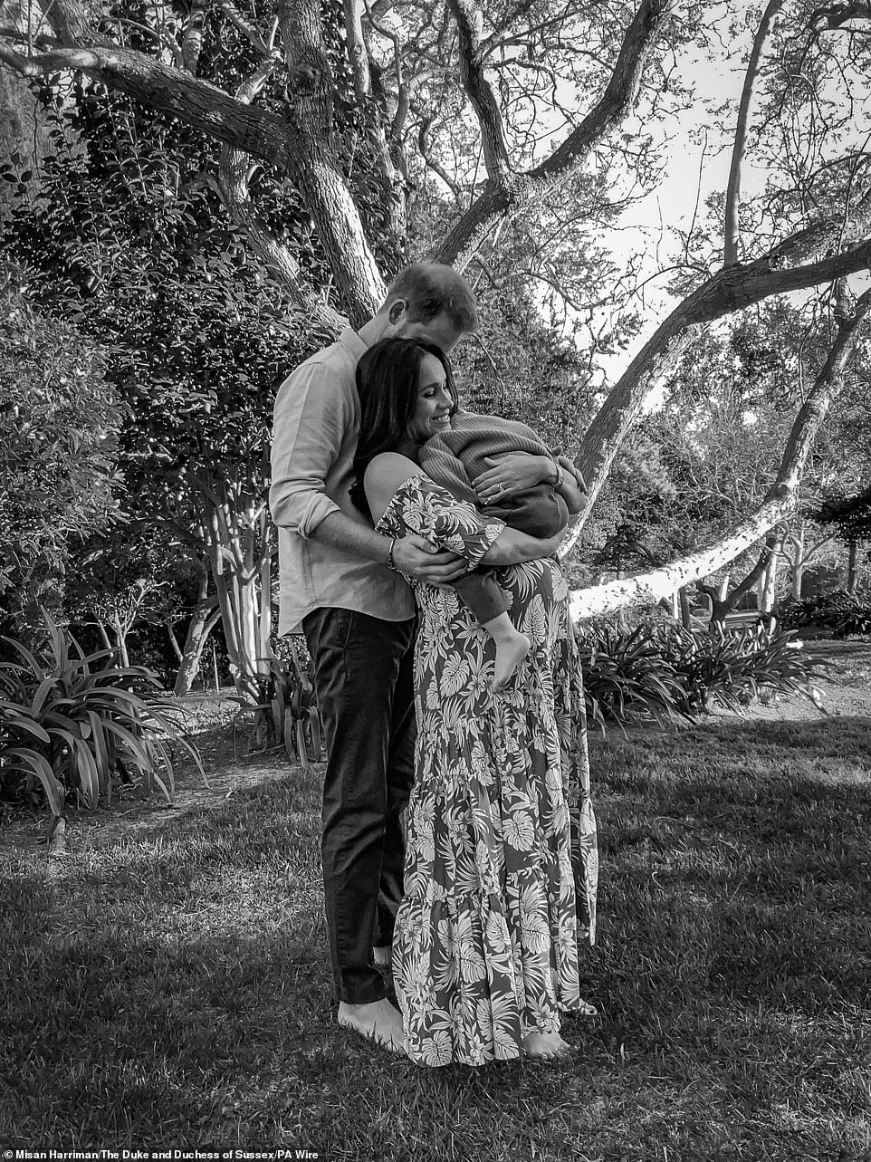 The Duke and Duchess of Sussex released this black and white Instagram photo of them cradling Archie hours after their bombshell interview with Oprah aired