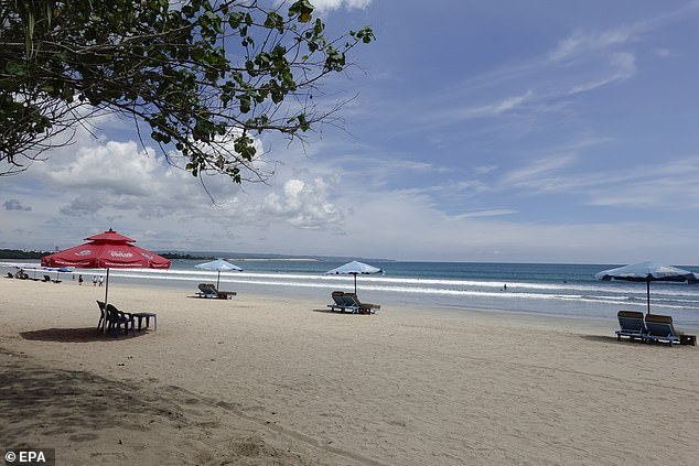 The popular Kuta beach is now only used by locals, with tourists banned from entering Bali