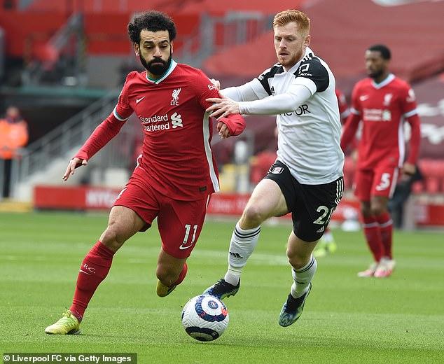 Harrison Reed keeps tabs on Liverpool dangerman Mohamed Salah during Fulham's win