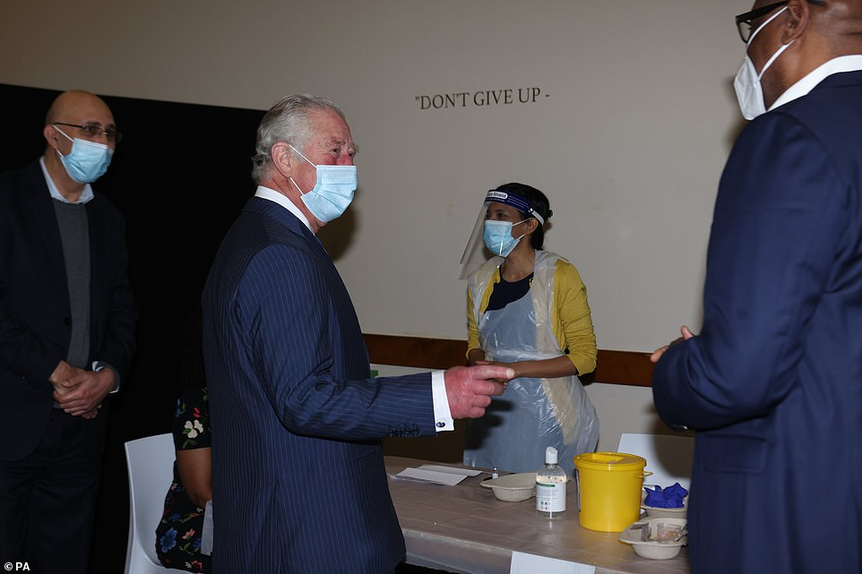 The Prince of Wales with Pastor Agu Irukwu (right) during his visit to an NHS vaccine pop-up clinic at Jesus House church