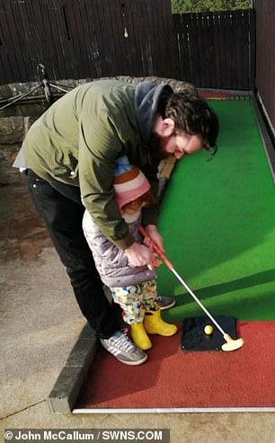 John McCallum and daughter Emma play golf