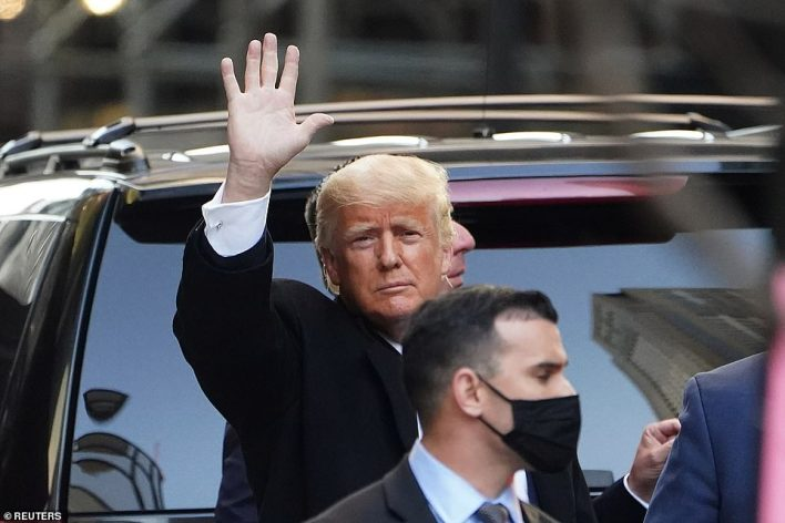 Trump waved to the gathered crowds on his way to the airport to return to Florida