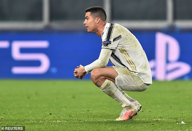A despondent Ronaldo reacts at the full-time whistle as Juve crash out of Europe once again