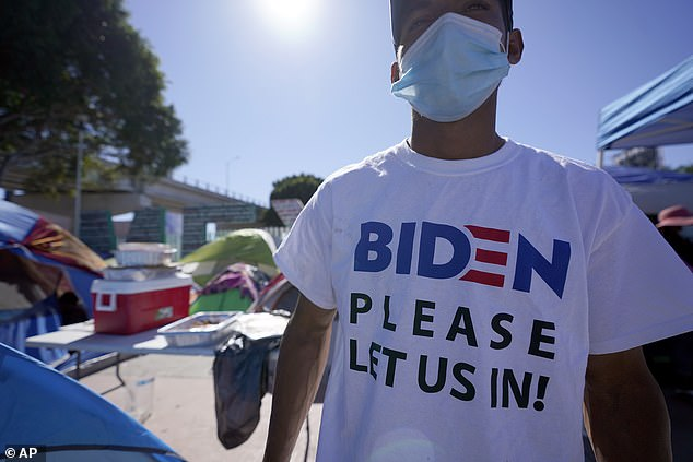 A Honduran man in Tijuana is seen on Monday awaiting his chance to seek asylum in the US