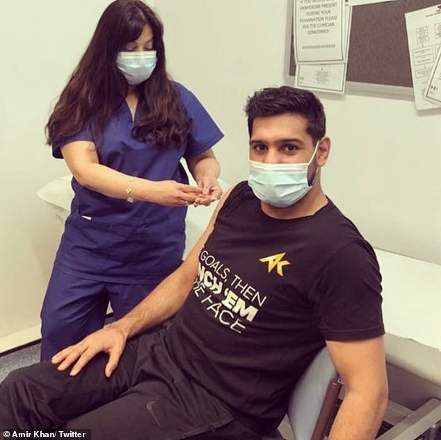 Amir Khan, 34, has been questioned after receiving his coronavirus vaccination early