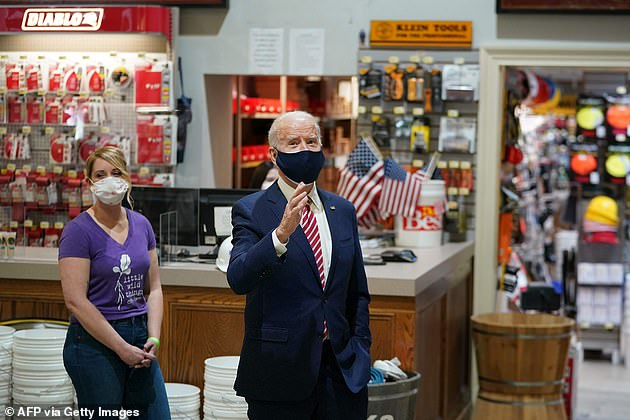 Concerns have been raised from both sides about Biden's failure to hold a Q&A with the press, especially after his aides refused to let the president answer questions from reporters as he visited a hardware store in Washington, DC, on Tuesday (as pictured above)