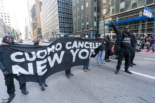 Activist with VOCAL-NY block traffic on 3rd Ave. outside New York Gov. Andrew Cuomo's office, Wednesday in New York. The activists were demanding Cuomo's immediate resignation and a state budget that funds housing, health care and economic relief for everyday people