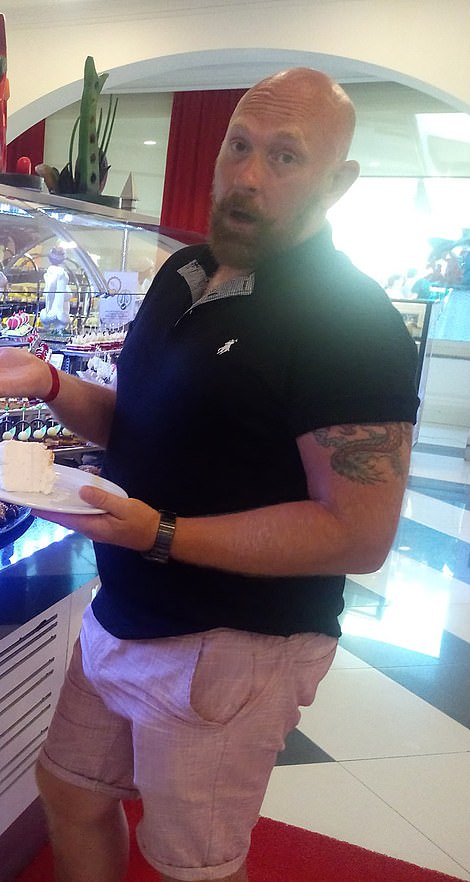Wayne Couzens, pictured here holding a piece of cake, is understood to be currently sporting a beard like the one above