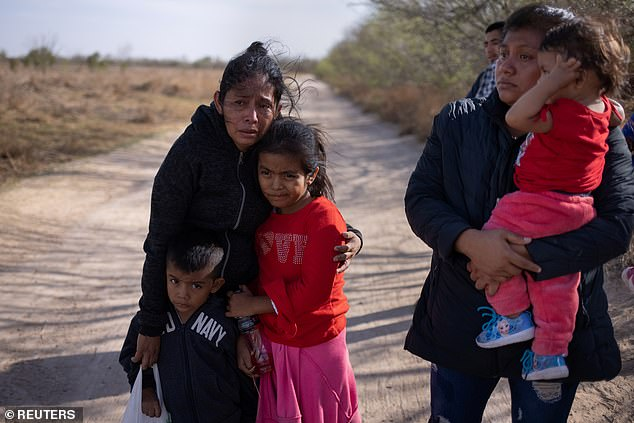 A group of migrants from Guatemala are seen in Texas on Wednesday, having crossed the Rio Grande from Mexico