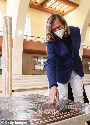 The mosaic was identified and authenticated by architect and Roman coloured marbles and stones expert Dario Del Bufalo (pictured) after a chance encounter two women who recognised the artefact from the home of their friend, Helen Fioratti