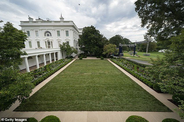Only Democrats will be present at Friday afternoon's ceremony in the White House Rose Garden (pictured) after no Republicans crossed the aisle to vote for the $1.9 trillion COVID-19 relief bill