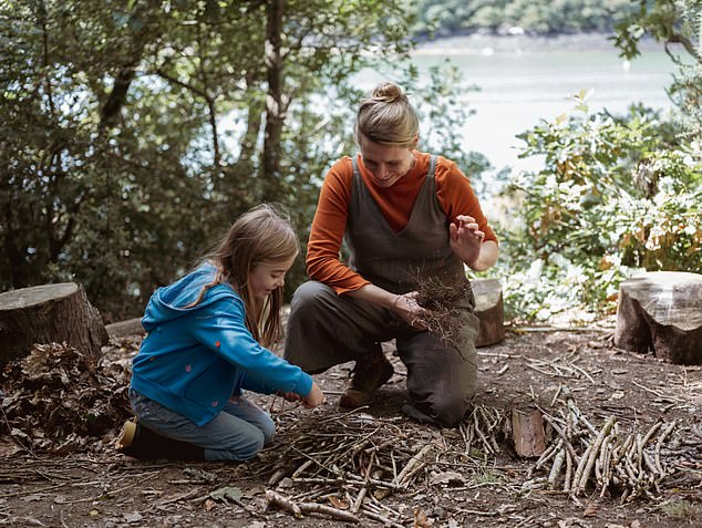 A mum and daughter learn how to create fire at 7th Rise near Truro in Cornwall