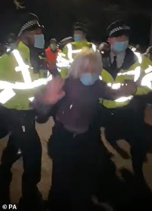Clips showed demonstrators being hauled off by police officers (one pictured) as horrifying screams ring out through the crowd