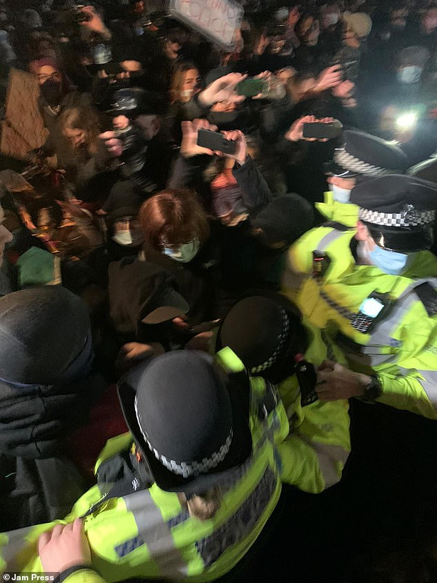 Officers pinned women to the ground to handcuff them - and London Mayor Sadiq Khan later slammed the police's 'unacceptable' response as 'neither appropriate nor proportionate'. He added that he was in contact with Met Police Commissioner Dame Cressida Dick. Pictured: Police at the vigil