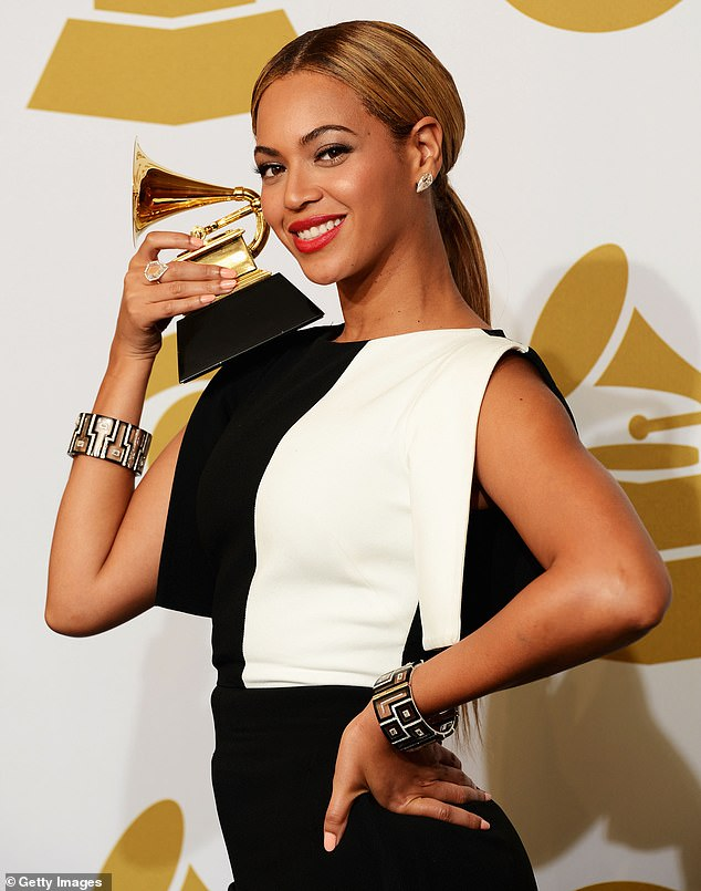 What could have been: The Recording Academy's interim chief executive Harvey Mason Jr. commented that Beyonce's decision not to perform at this year's event was 'unfortunate'; she is seen at the 55th Annual Grammy Awards in 2013