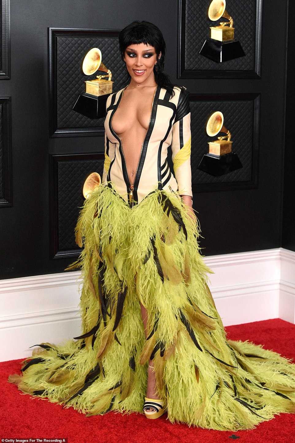 It's a look: Doja Cat put on an eye-popping display in a dress by Roberto Cavalli which featured an unzipped leather jacket with feather skirt attached