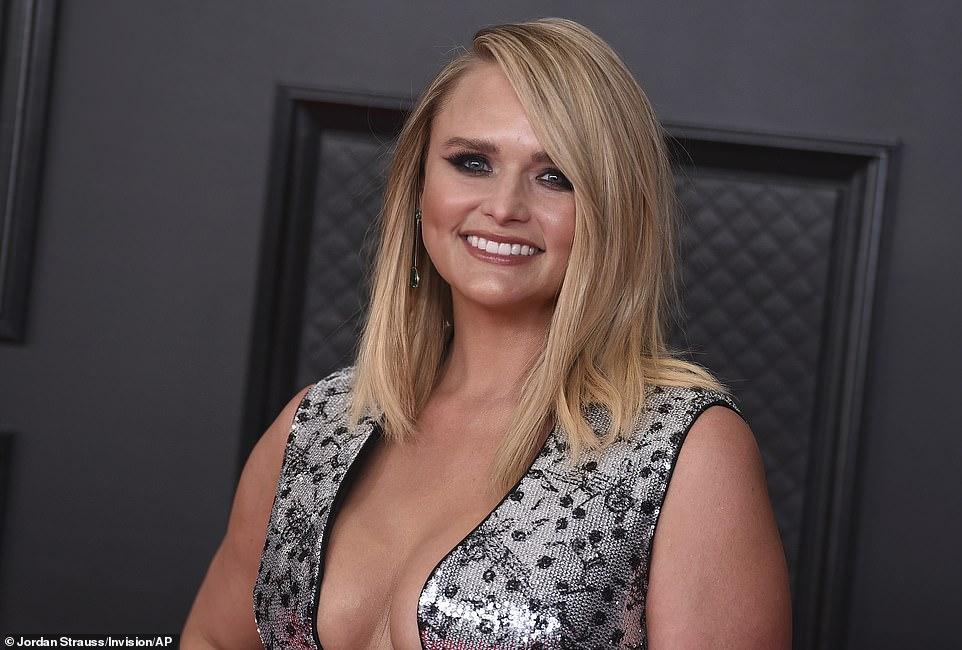 Heavy metal: The Somethin' Bad hitmaker wore her blonde locks in a sleek side part and wore smokey eye makeup