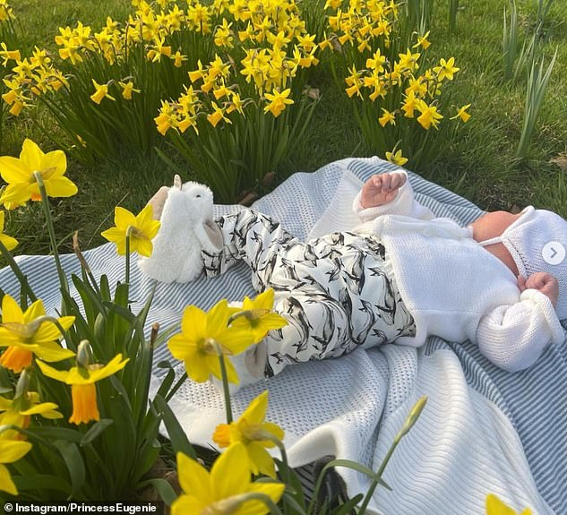 New mum Princess Eugenie shared an adorable snap of her and husband Jack Brooksbank's son August Philip Hawke Brooksbank lying among a field of brightly coloured daffodils (pictured)