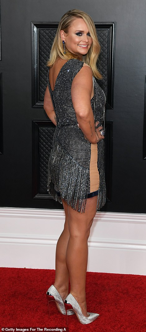 Wardrobe change: Miranda performed at the ceremony and then returned to the red carpet in a short tasseled number with silver heels