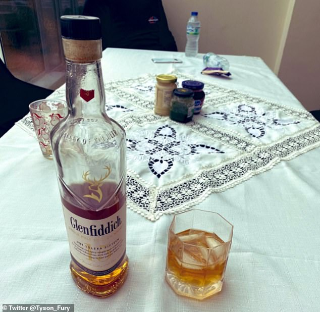 Fury also posted this image of a half-empty bottle of whisky and a full glass on Sunday