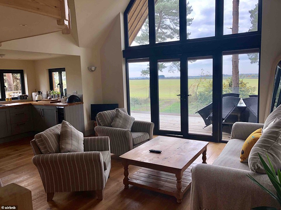 This luxury lodge for six costs £217 a nightand comes with 'incredible views across open unspoilt countryside', a hot tub, under-floor heating and is just 15 minutes' drive from Kings Lynn station