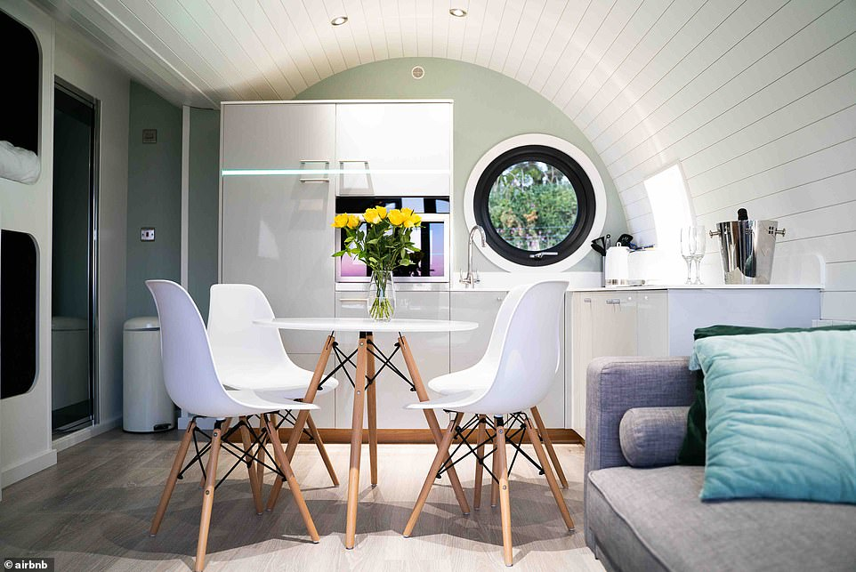 The listing invites you to stay at 'the ultimate in luxury glamping', a cabin with a full kitchen, two smart TVs, a hot tub, Wi-Fi and 'amazing views'. It sleeps four and costs £140 a night