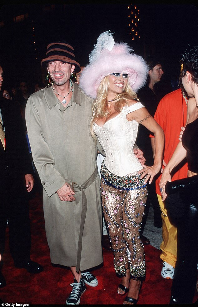 Not their best look: But it was the couple's outrageous look at the 1999 MTV Video Music Awards that inspired her in 2018. Pam wore a pink feathered hat and corset then, while Tommy was naked under a trench coat