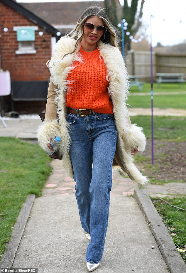 Standing out; She opted for flared blue jeans and silver heels as she strutted into filming