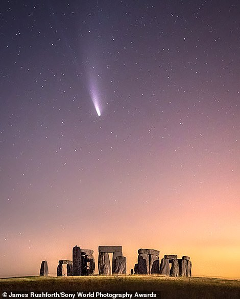 Comet Neowise streaks over Stonehenge in this amazing shortlisted landscape image by Briton James Rushforth. He said: 'It's fascinating to think that this historic site did not even exist when Neowise last passed the Earth. The comet is due to return in approximately 6,800 years. I wonder if the stones will still be standing then. This is a single-exposure photograph taken early on the morning of July 20 [2020]. The orange glow is light pollution from the nearby villages of Durrington and Larkhill, and a passing lorry very kindly painted the rocks with light'