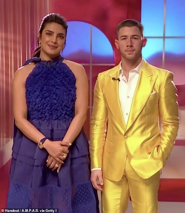 Powerful foe: An Australian entertainment reporter has been forced to set his Twitter account to private after being savaged by Priyanka Chopra's 27 million followers. Priyanka (left) is seen here with husband Nick Jonas (right) on Tuesday