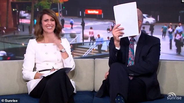 'I can't watch it':As the camera zoomed in on Sam's wetsuit, Sunrise co-hosts Natalie Barr (left) and David 'Kochie' Koch (right) burst into laughter