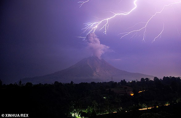 Mount Sinabung in Karo, North Sumatra, erupted with hot ash climbing 16,400ft into the sky and volcanic debris depositing on nearby villages