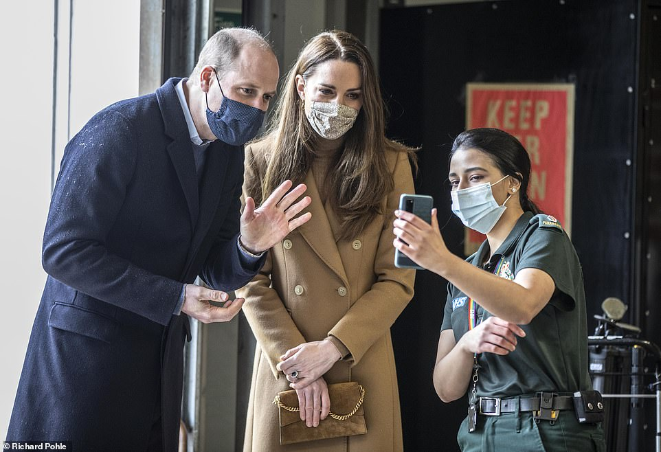 William and Kate talk with the family of paramedic Jahrin (Jay) Khan via a mobile phone. The family is in London but her father joined the conversation from Bangladesh. Ms Khan has been unable to see her family through the pandemic
