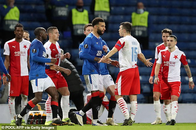 Connor Goldson (centre) remonstrated with Kudela (third-right) as tempers flared at Ibrox